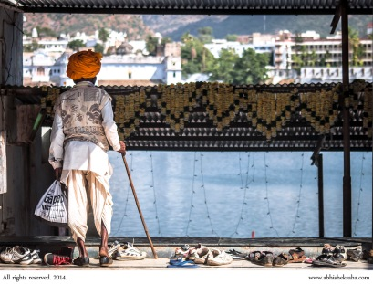 An old man checks out the Pushkar Lake before going for the holy dip.