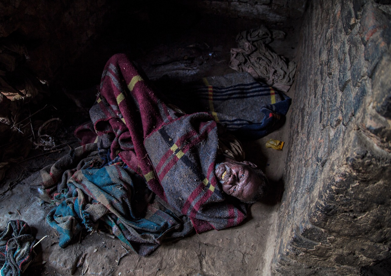 Bhola Birhor lies paralyzed in his hut in Tilra village.His wife Ratni died in September, 2011 at the age of 55 due to starvation related complications. Her death had caught the state's attention, triggered outrage and prompted government interventions.