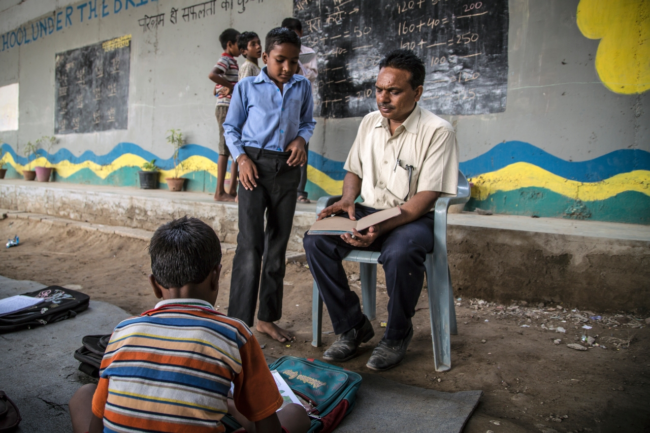 Rajesh Kumar Sharma teaches a student at the Free School. (